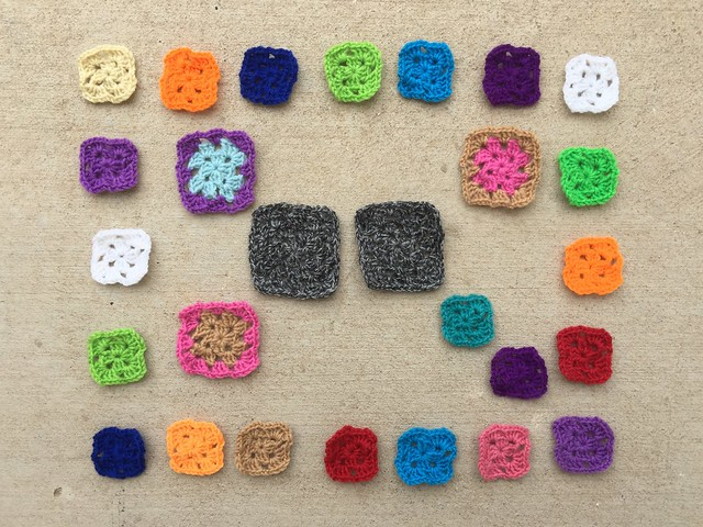 Twenty-seven crochet remnants ready for rehab