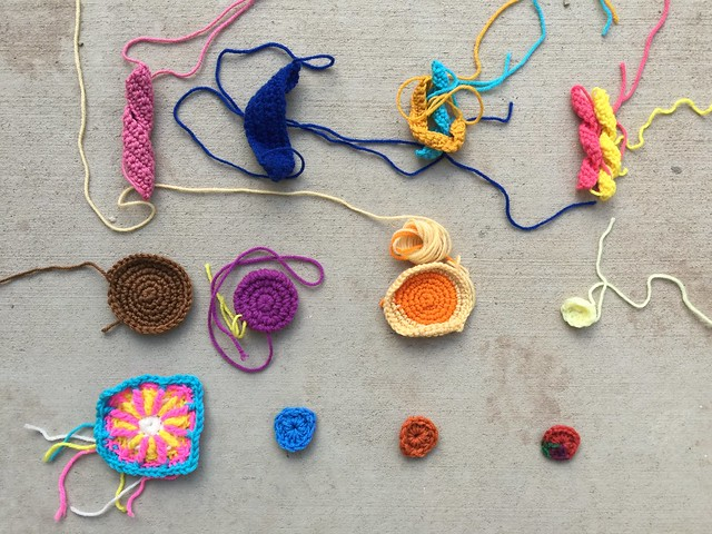 Crochet remnants for twelve future crochet squares