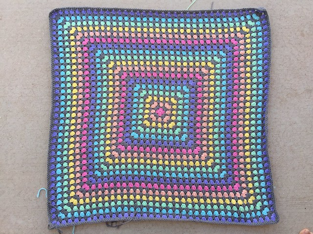 A thirty-six round great granny square that needs to be blocked, so it is not done, but it is done-ish