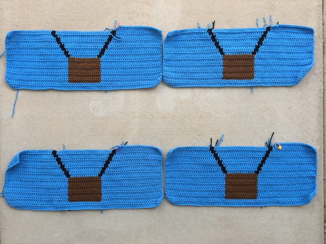 The first eighteen rows of four crochet panels depicting the basket of a hot air balloon