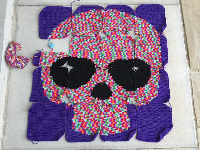 A Day of the Dead crochet yarn bomb almost ready to be assembled