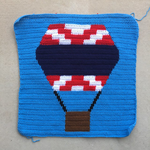 A red, white, and blue hot air balloon crochet panel