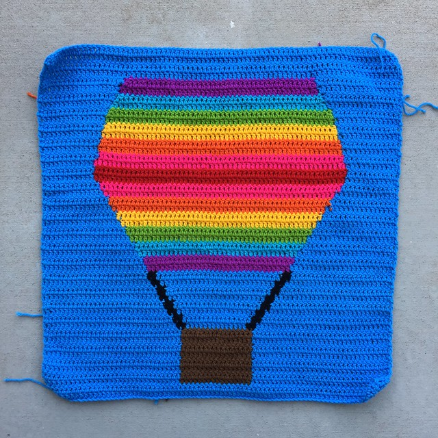 The first completed crochet panel with a rainbow inspired hot air balloon
