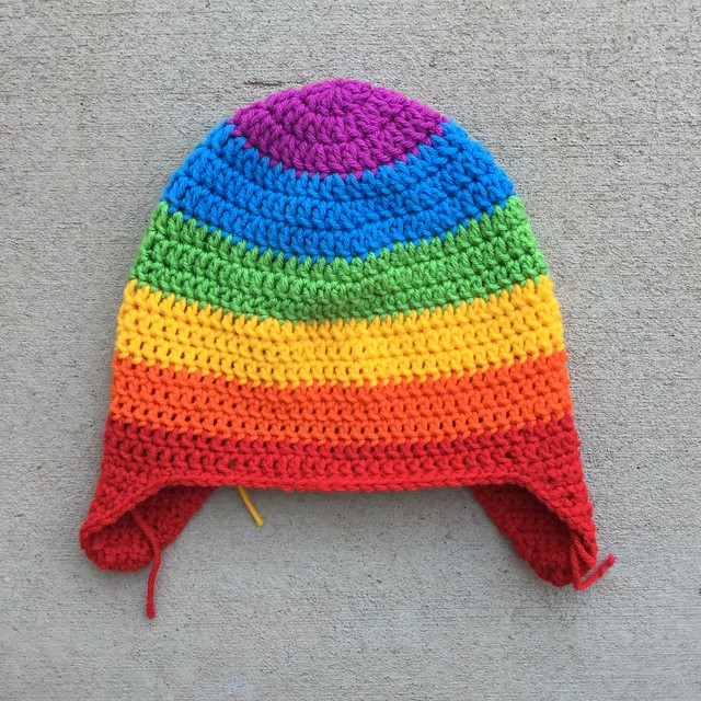 A rainbow inspired crochet hat for an adult worked in six different colors