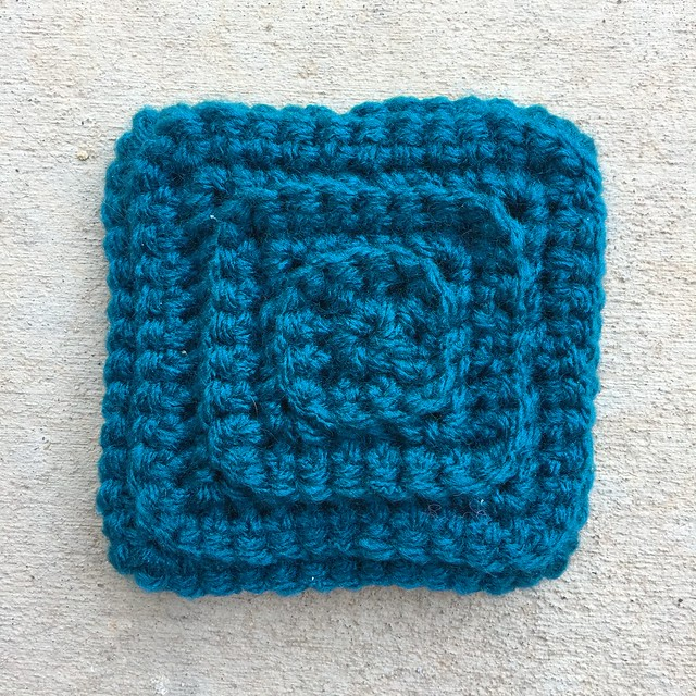 A teal textured crochet square that served to distract me like a shiny crochet object