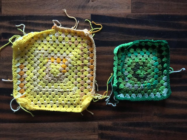 """The """"after"""" of """"before and after"""" using yarn scraps to crochet a yellow granny square and a green granny square."""