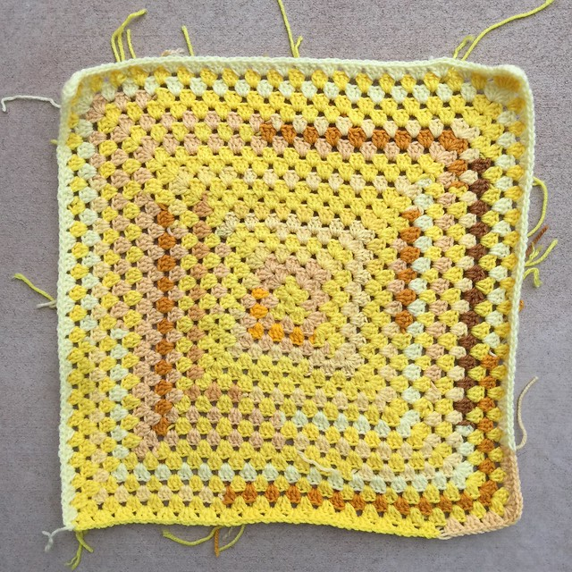 A yellow scrap yarn granny square, my largest of January 2020