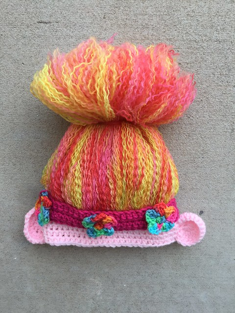 My first crochet troll hat with ears and flowered headband attached and ready for adventure