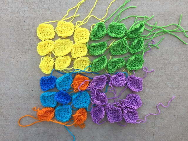 Thirty-five crochet sudoku solving squares with ends to be woven in