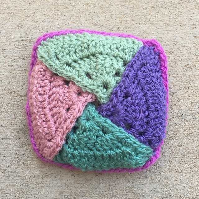 A crochet coin purse filled with quarters