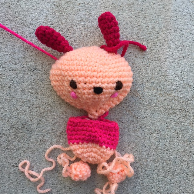 Feeling dissatisfied with Pochacco's first sweater, I decided to frog it out and recrochet it in a new and darker pink.