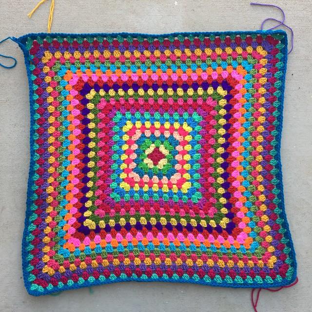 A twenty-six round multicolor granny square