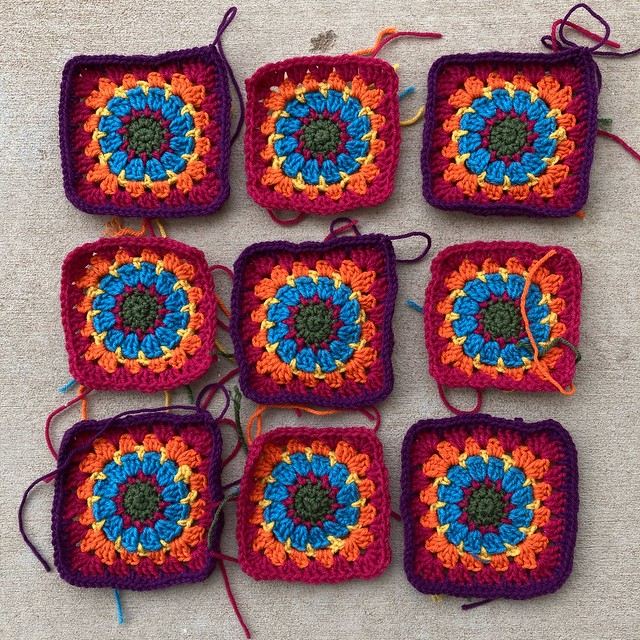 The crochet beat goes on with five of the nine squares ready to have their ends woven in and trimmed