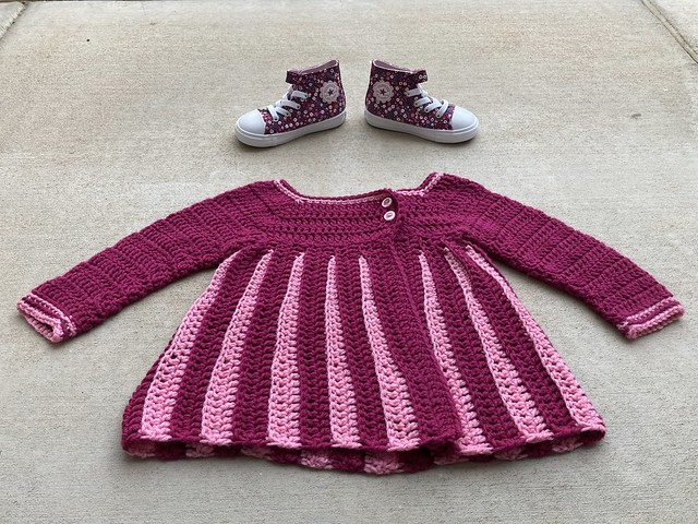 A pair of shoes with a coordinating crochet sweater