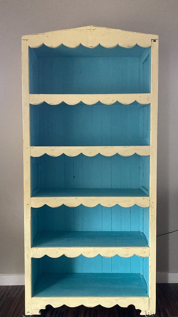 a new yellow and turquoise bookcase