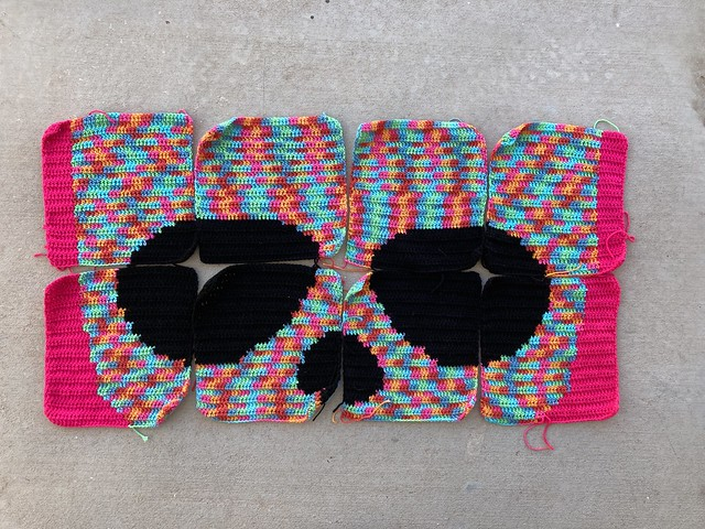 I correct my crochet mistakes and finished four more crochet squares for a variegated sugar skull yarn bomb