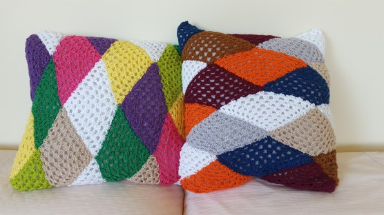 two triangle cushions side by side
