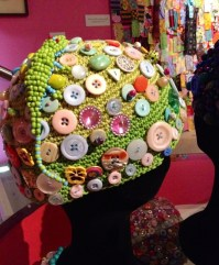 Crocheted hats with buttons.