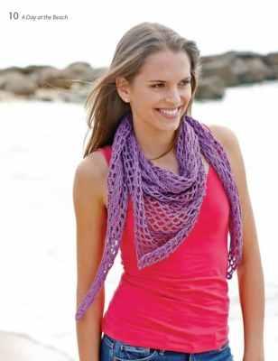 Woman wearing a triangular shawl.