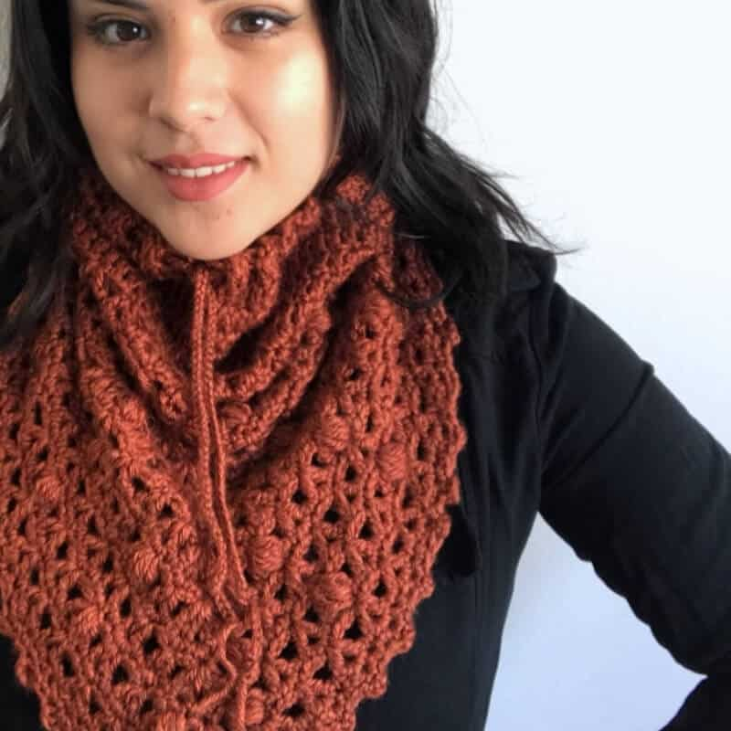 Photo of a woman wearing the Serenity Snood Triangle Cowl on her neck