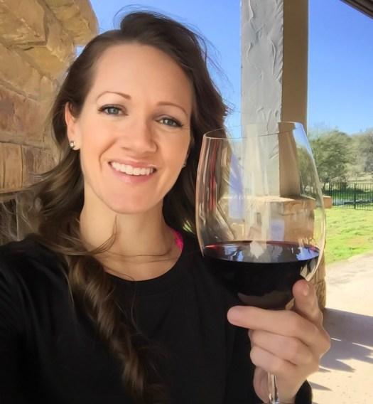 Steph drinking wine on patio