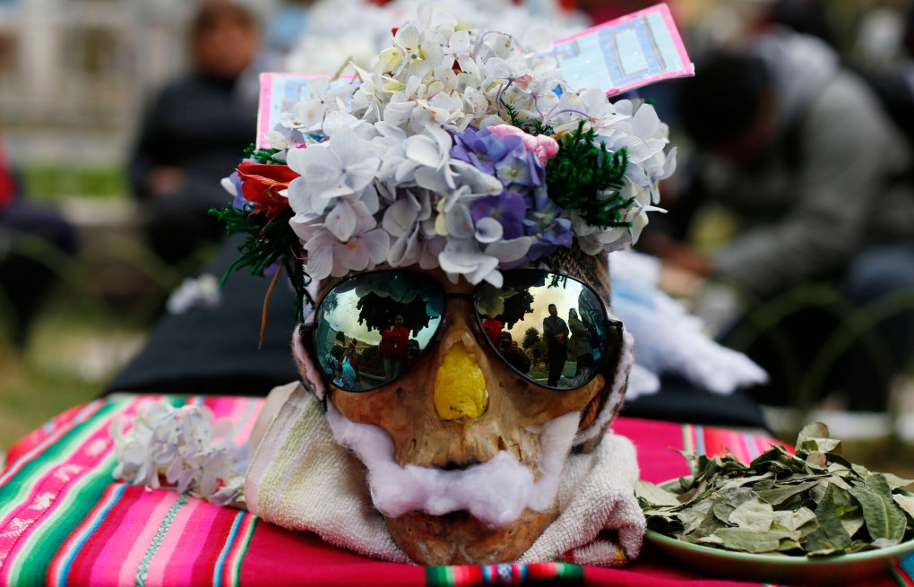 Ñatitas are adorned with sunglasses, floral crowns, cotton and offerings of cocoa leaves