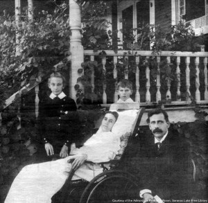 Family next to their ailing mother in front of the Noyes cure cottage