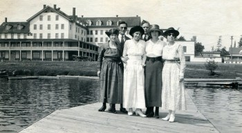 The expansive Paul Smith's Hotel behind a group on women on St. Regis Lake