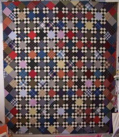 Made with 2-color 9 Patch and plaid alternate blocks.