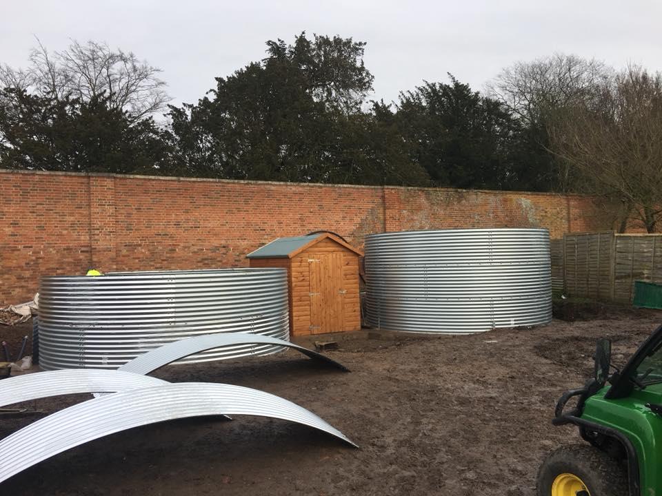 Irrigation system header tanks