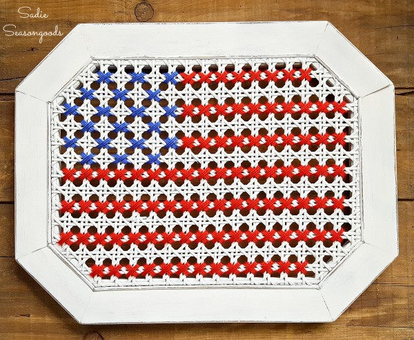 Sadie_Seasongoods_broken_cane_table_repurposed_into_oversized_cross_stitch_American_flag_USA