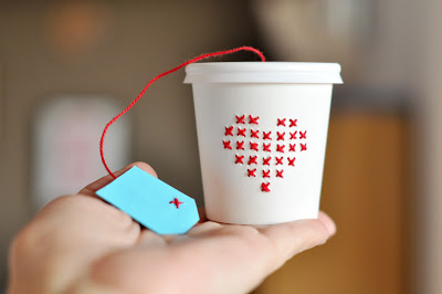 cross stitch on a paper cup