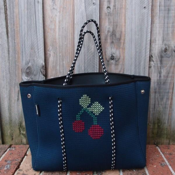 cross stitch on neoprene bag