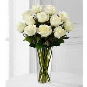 dozen white roses in vase