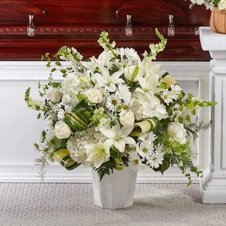 a mix of white flowers in a floor arrangement