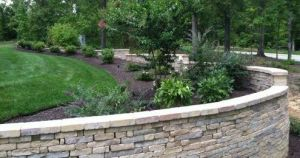 retaining wall, stone, multi colored stone, inspired landscaping, beautiful view, boundaries