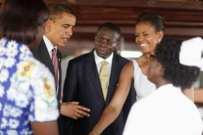U.S. President Barack Obama and first lady Michelle Obama meet with pregnant women during a tour of LA General Hospital in Accra July 11, 2009.