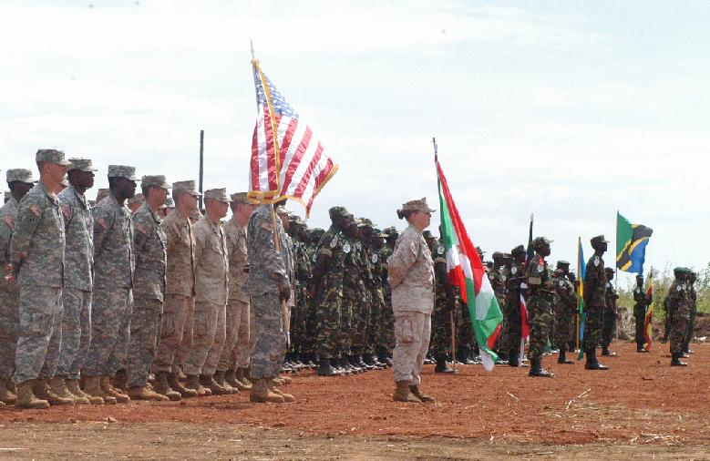 KITGUM, Uganda - Soldiers from Kenya, Burundi, Rwanda, Tanzania, Uganda and the United States participate in an opening ceremony at the start of Natural Fire 10, October 16, 2009. Natural Fire 10 is a multi-national, globally-resourced exercise focused on humanitarian assistance, disaster relief, and regional security. (Photo courtesy of U.S. Army Africa)