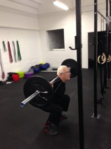 Jeff doing a back squat at CrossFit Blackwater, Witham Essex