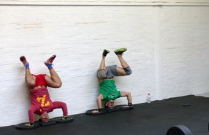 Simon and Steve doing handstand pushups in 15.4