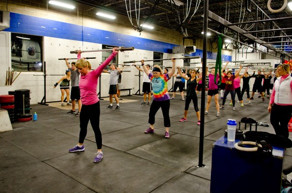 In the OHS, proper positioning of the barbell overhead in the frontal plane is key to a successful lift.