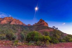 Full moon over Sedona red cliffs at twilight. This symbolizes perceiving new possibilities that help expand horizons.