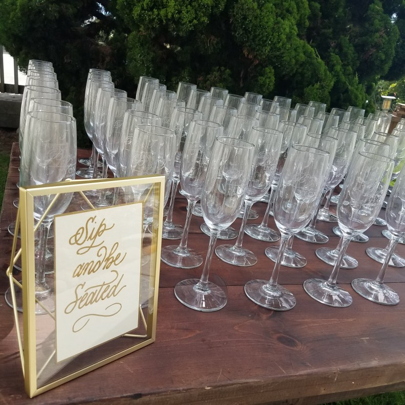 Calligraphy wedding sign for champagne toast
