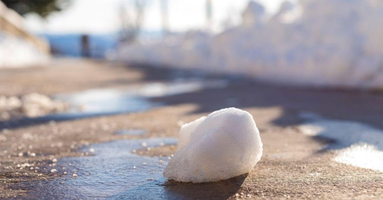 Snowball melting on pavement