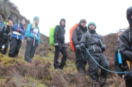 Demonstrating techniques for group management on steep ground with a confidence rope
