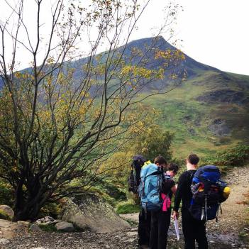 The CrosstheUK team putting their map skills to test as they go off the trail and make their own way up Blencathra.