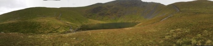 A panoramic view of Scales Tarn on Blencathra in the North Lake District