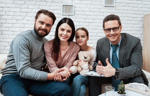 family with therapist in home