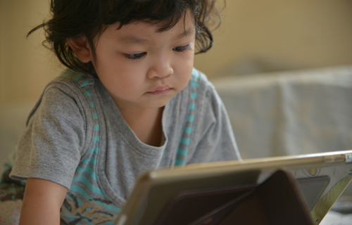toddler on tablet device