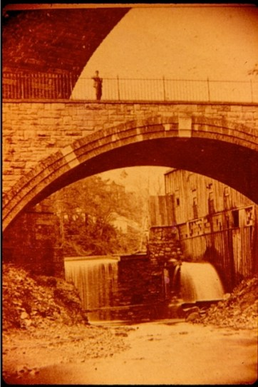Later view from the Kill, showing the Arcade File Works mill dam and water wheel.